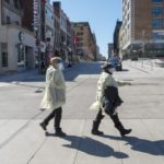 Health-care workers walk to work