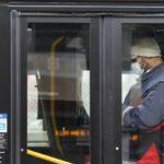 Toronto public transit worker wears a mask in a bus