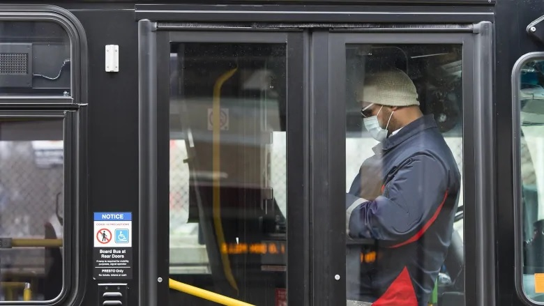 Toronto public transit worker wears a mask in a bus